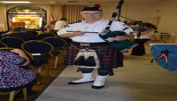Greg Nicolosi played the bagpipes